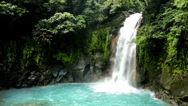 costa rica rio celeste waterfall tenorio national park - waterfall stock videos & royalty-free footage
