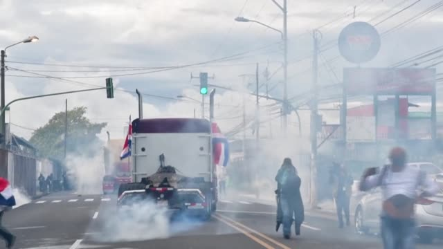 costa rican riot police used tear gas on monday to disperse demonstrators who attacked and threw stones at the officers - costa rica stock videos & royalty-free footage