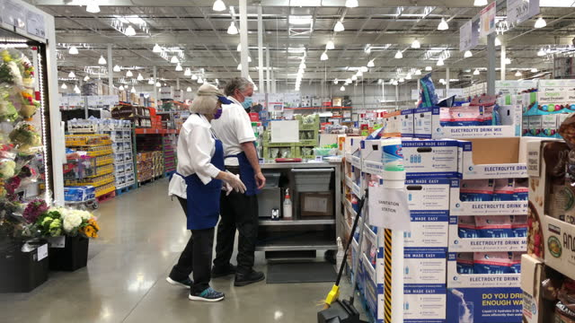 costco food demonstrators are getting ready for food samples service at the costco wholesale store, it was suspended due to the coronavirus pandemic... - active seniors stock videos & royalty-free footage