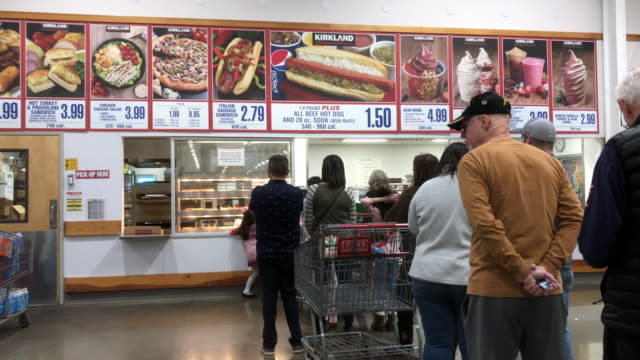 costco is an american multinational corporation which operates a chain of membershiponly warehouse clubs - hot dog stock videos & royalty-free footage