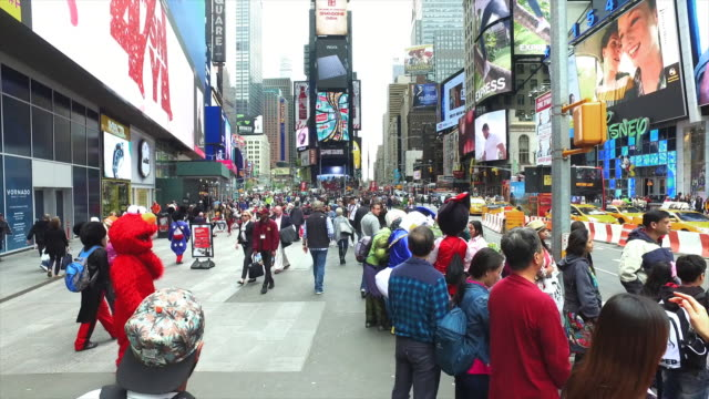 costume characters and tourists in times square - international landmark stock videos & royalty-free footage