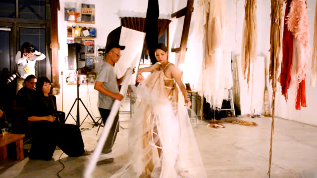 costume designer araki shiro, who has worked with such artists as lady gaga and japan's misia and ko shibasaki, dresses model sachi in layers of... - fukuoka prefecture stock videos & royalty-free footage