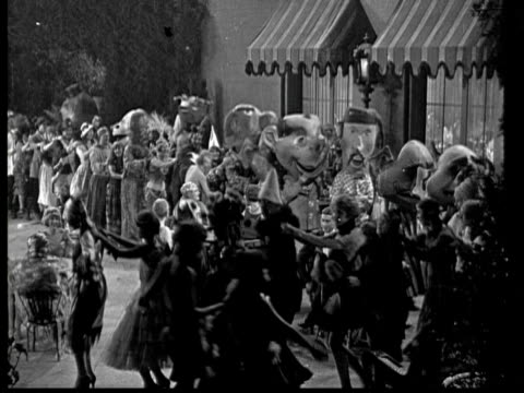1925 ms b/w costume party in garden at night - silent film stock videos & royalty-free footage