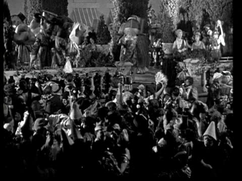 1925 ha ms b/w costume party in garden at night - 1925 stock videos & royalty-free footage