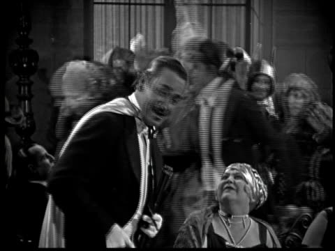 1925 ms b/w costume party, man and woman laughing - 1925 stock videos & royalty-free footage