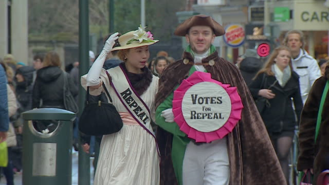 costumed campaigners urging people in dublin to vote in a referendum to repeal the law which bans abortions - republic of ireland stock videos & royalty-free footage