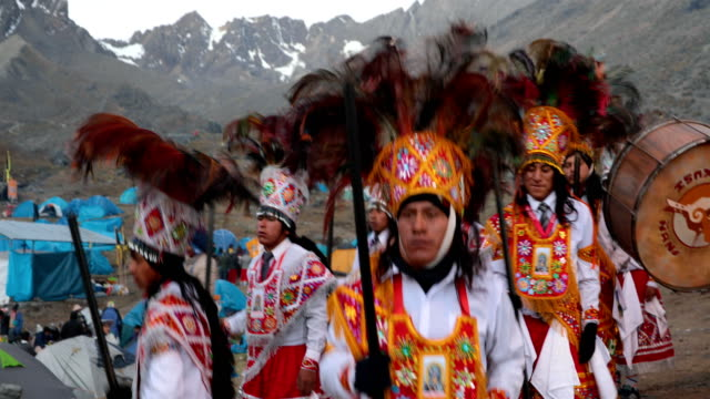 costumed dancers parade at a chapel on the first day of the annual qoyllur rit'i festival on may 27, 2018 in ocongate, peru. every year, since 1783... - religious celebration stock videos & royalty-free footage