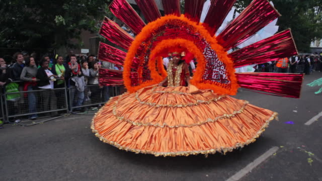 ws costumed dancers parade in notting hill carnival / london, united kingdom - notting hill videos stock videos & royalty-free footage