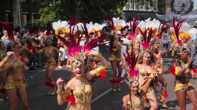 WS Costumed dancers parade in Notting Hill Carnival / London, United Kingdom