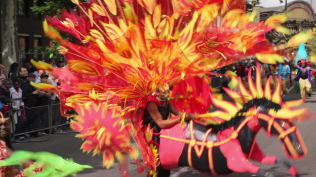 ws costumed dancers parade in notting hill carnival / london, united kingdom - creativity stock videos & royalty-free footage