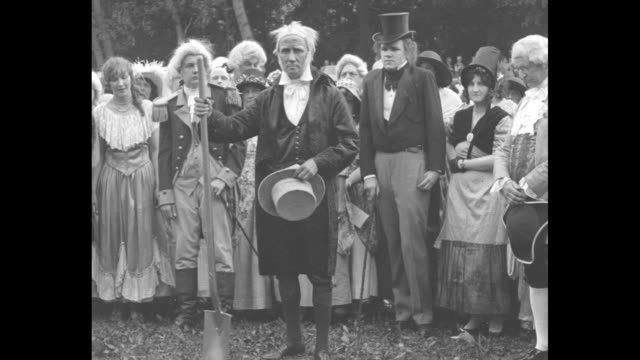 costumed men in colonial garb step from a barge / a crowd, all in costume singing; an old man speaks and digs hard soil with a shovel; he stands with... - barge stock videos & royalty-free footage