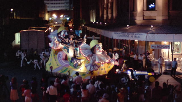1984 ha ws costumed woman dressed as queen riding on parade float and waving to spectators during annual mardi gras parade in the french quarter / new orleans, louisiana, usa - festwagen stock-videos und b-roll-filmmaterial