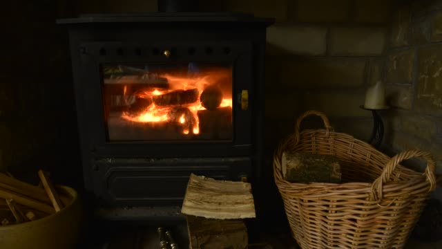a cosy fireplace with log burner - log stock videos and b-roll footage