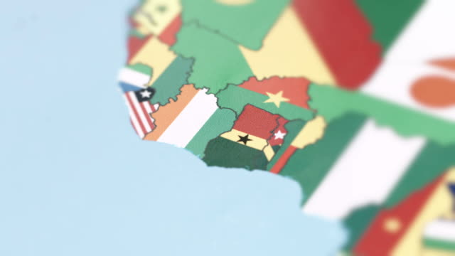 cote divoire borders with national flag on world map - ghana stock videos and b-roll footage