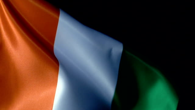 cote divoire flag flapping - côte d'ivoire stock videos & royalty-free footage