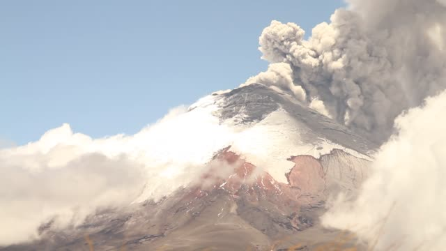 cotopaxi volcano spewing vapor and ash during erupting process - volcanic crater stock videos & royalty-free footage