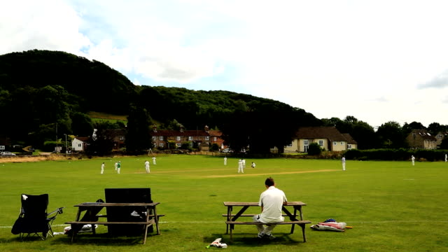 cotswolds stinchcombe england village cricket green players team - cricket video stock e b–roll