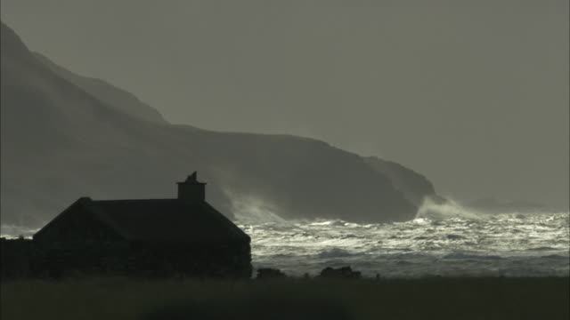 ms cottage by stormy sea in the hebrides on the west coast of scotland - scotland stock videos & royalty-free footage