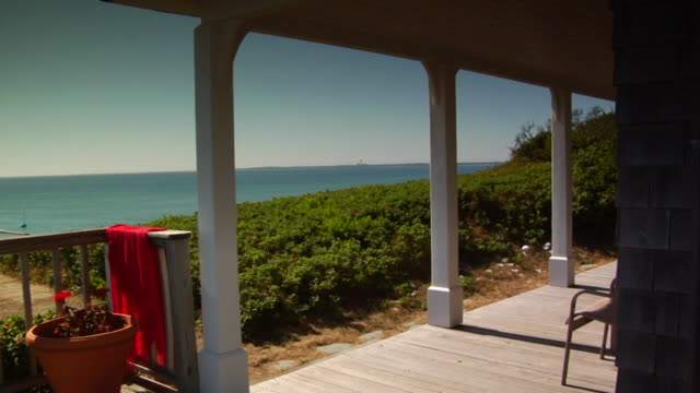 ms, cottage porch overlooking ocean, north truro, massachusetts, usa - porch stock videos & royalty-free footage