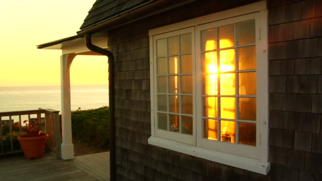 ms, cottage window from porch at sunset, north truro, massachusetts, usa - landhaus stock-videos und b-roll-filmmaterial