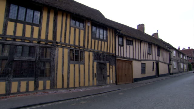 cottages line a street in the medieval village of lavenham. available in hd. - lavenham stock-videos und b-roll-filmmaterial