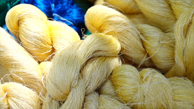 cotton from silkwarm raw for fabric factory. - thread stock videos & royalty-free footage