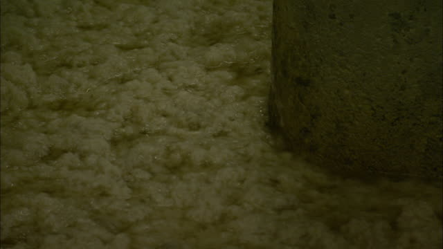 cotton is washed as it travels through a paper mill. - mill stock videos & royalty-free footage
