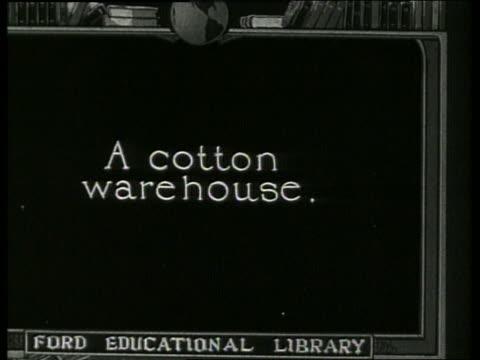 "slate ""a cotton warehouse."" / 1910 / no sound - 1910 stock-videos und b-roll-filmmaterial"
