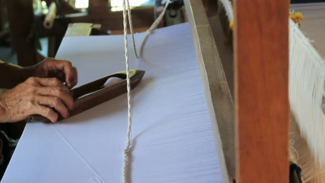 Cotton weaving on a loom