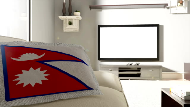 couch and tv with flag of nepal - nepali flag stock videos & royalty-free footage