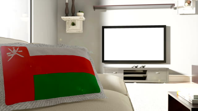 couch and tv with flag of oman - oman flag stock videos and b-roll footage