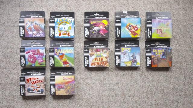 vídeos y material grabado en eventos de stock de cougar boy video game boxes disappear one by one stop motion - juego electrónico de bolsillo