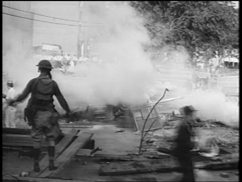 b/w 1932 coughing veterans walking by soldier with gas mask gun / bonus march / washington dc - gas mask stock videos & royalty-free footage