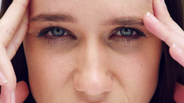 could these headaches be lated to eye problems? - cornea stock videos & royalty-free footage