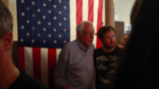 senator bernie sanders who is running for the democratic nomination for president of the united states poses for selfies with supporters during the... - presidential candidate stock videos & royalty-free footage