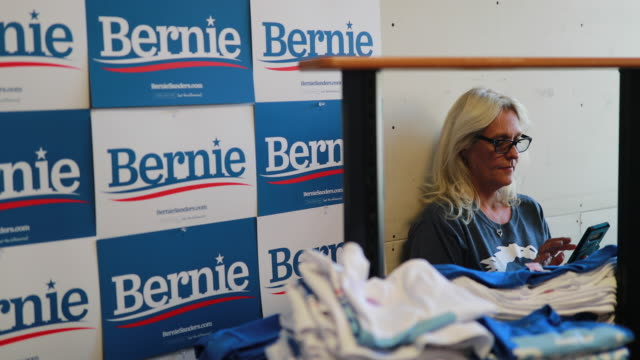 stockvideo's en b-roll-footage met signs and tshirts promote senator bernie sanders who is running for the democratic nomination for president of the united states during the opening... - presidentskandidaat