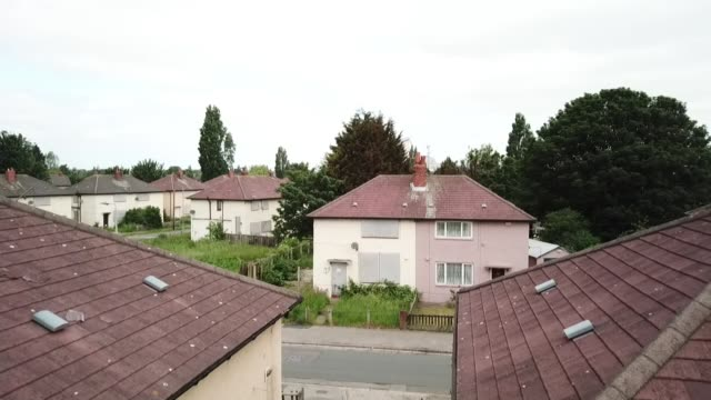 council estate in hull dogged by delays and anti-social behaviour; uk, east yorkshire, kingston upon hull: drone footage of derelict council houses... - disrespect stock videos & royalty-free footage