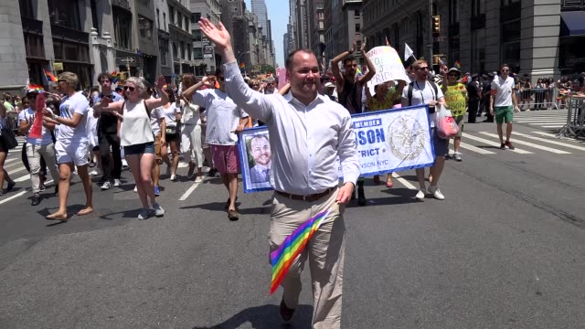 council member corey johnson greets crowd during the new york city gay pride parade 2016 / 5th avenue manhattan new york city usa / corey johnson is... - hell's kitchen stock videos and b-roll footage