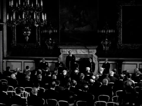 vídeos de stock, filmes e b-roll de council of europe meeting at st james's palace england london st james's palace int harold macmillan mp speaking to audience sot that great meeting... - the hague