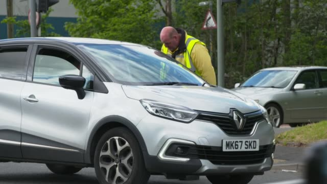 council rubbish tips reopen with strict rules after fly-tipping surges; england: manchester: ext man directing traffic at council rubbish tip waste... - stack stock videos & royalty-free footage