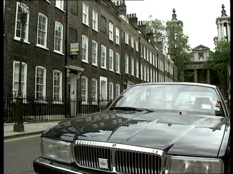 extra band added c4n england london westminster cms front of expensive car as row of expensive town houses in b/g ms row of town houses gv ditto - expense stock videos & royalty-free footage