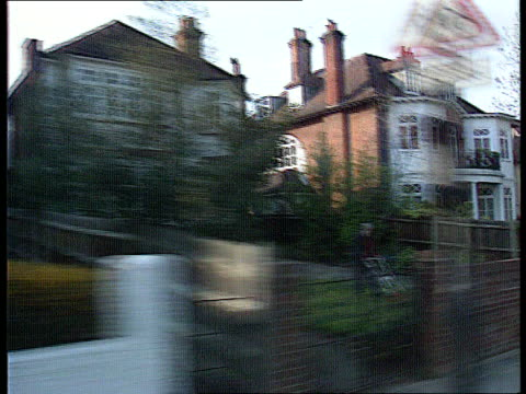 extra band added ext haringey gv expensive surburban houses track cr2012 tlms big house 15290/itn richmond ms terraced housing as old man towards tx... - richmond upon thames stock-videos und b-roll-filmmaterial