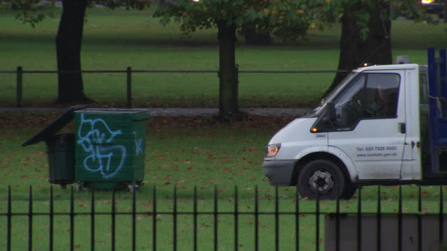 council worker picks up litter in a park, london - bin bag stock videos & royalty-free footage