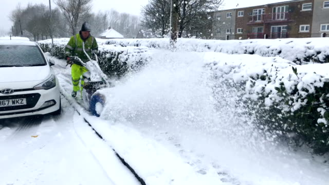 A council worker uses a machine to clear snow from pavements on January 16 2018 in Harthill Scotland Snow and sleet conditions are affecting large...