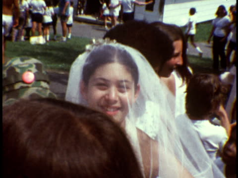 1973 ms counselor pretending to marry camper at marriage booth at camp sussex summer camp / sussex, new jersey - summer camp helper stock videos & royalty-free footage