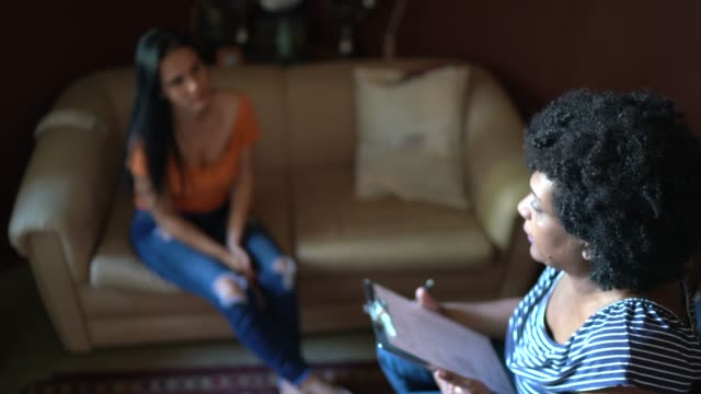 counselor / therapist listens to female client at her home - mental health professional stock videos & royalty-free footage