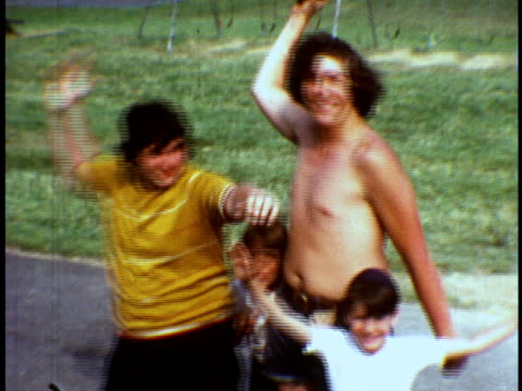 stockvideo's en b-roll-footage met 1973 ms counselors playing dodgeball with campers at camp sussex summer camp / sussex, new jersey - sociale geschiedenis