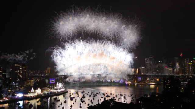 Countdown and opening sequence of the Sydney Fireworks over the Sydney Harbour Bridge and Sydney Opera House on New Year's Eve at Sydney Harbour on...