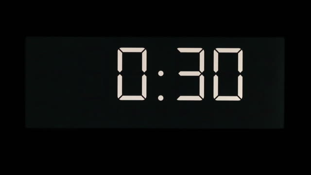 countdown from 30 seconds to zero on digital fluorescent display - 30 seconds or greater video stock e b–roll