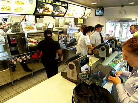 counter at mcdonald's / burger cartons / worker putting burgers on buns on september 19, 2007 / sheffield, england / audio - ordering stock videos & royalty-free footage